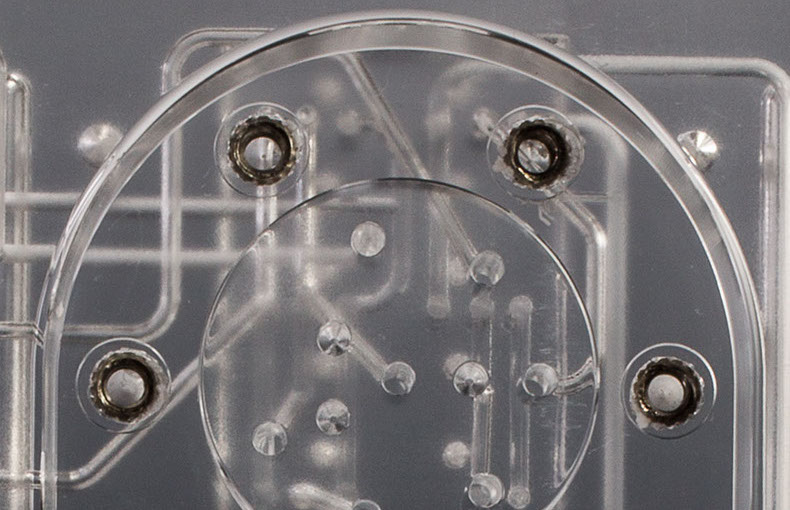 Close up of Steel Inserts in a Threaded Port in a Diffusion Bonded Plastic Manifold