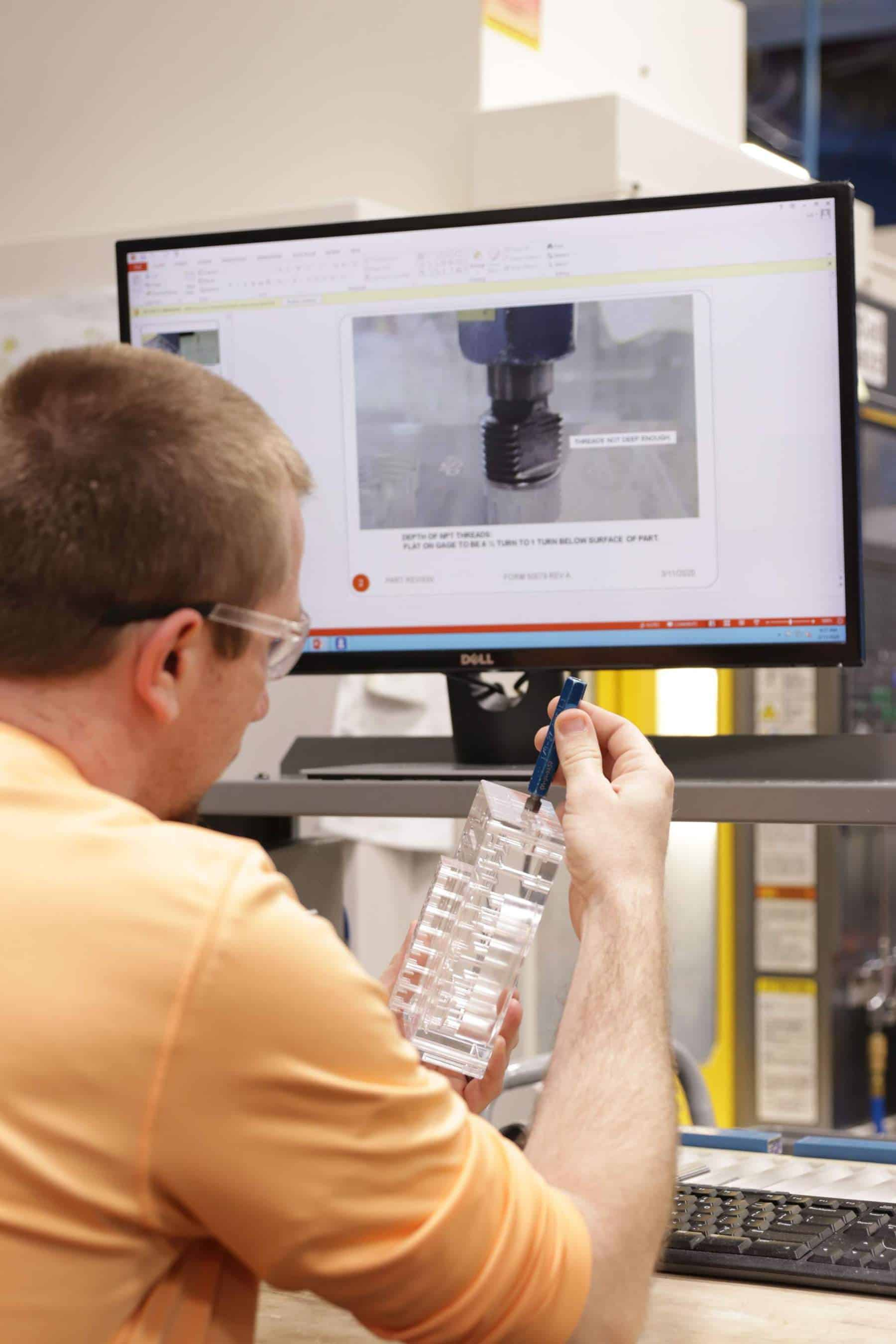 Plastics Machinist Verifying Procedures Using Visual Work Instructions for Plastic Manifold