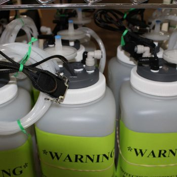 Polymer Tubing Attached to Custom Caps of Fluid Storage Bottles with Level Sensors & Wiring